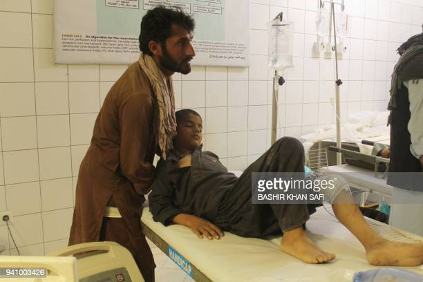 An Afghan resident is treated at a hospital following an airstrike in Kunduz on April 2 2018 An Afghan airstrike on a religious school in a Taliban...