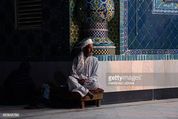 An Afghan resident looks on as he sits in the courtyard of the HazrateAli shrine or Blue Mosque during the Islamic holy month of Ramadan in Mazari...