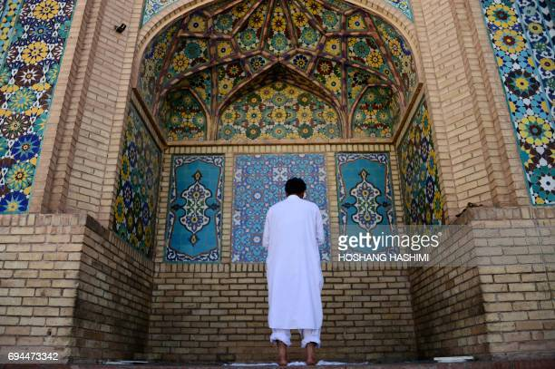 An Afghan resident offers prayers at a mosque in Herat on June 10 2017 Muslims throughout the world are marking the month of Ramadan the holiest...
