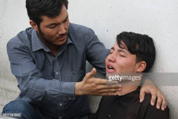An Afghan resident weep for his relative following a suicide attack in Kabul on August 15 2018 At least 37 people the majority of them students were...
