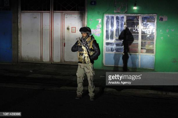 An Afghan security forces member stands guard after an armed attack towards a police headquarters in Herat Afghanistan on January 12 2019
