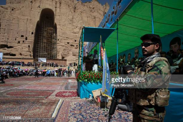 An Afghan security guard watches the crowd during the final campaign rally for Abdullah Abdullah Chief Executive of Afghanistan in Bamiyan...