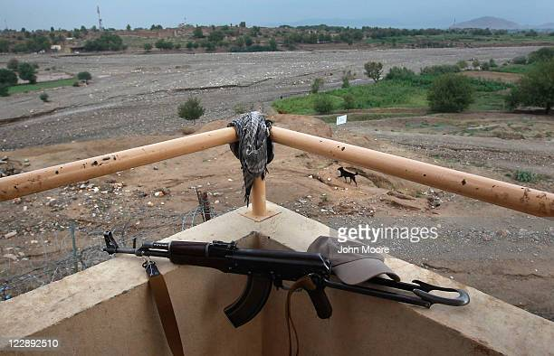 An Afghan security guard's AK47 rifle lies on a guard tower on the perimeter of US Forward Operating Base Shinwar on August 29 2011 in Shinwar...