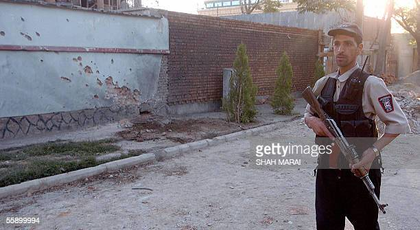 An Afghan security officer stands guard outside the Canadian embassy following a rocket attack in Kabul 12 October 2005 A rocket was fired at the...