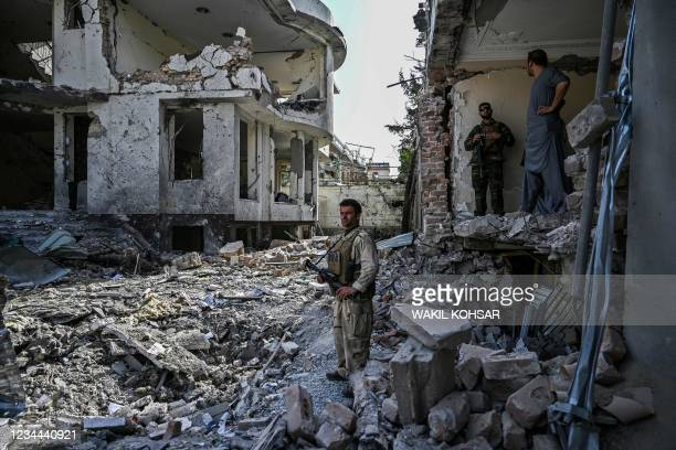 An Afghan security personnel inspects the site a day after a car bomb explosion in Kabul on August 4, 2021. / The erroneous mention[s] appearing in...