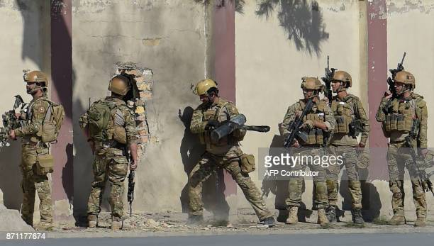 An Afghan security personnel take position after gunmen disguised as policemen stormed a television station in Kabul on November 7 2017 Gunmen...