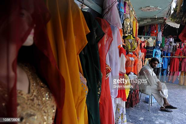 An Afghan shopkeeper waits for customers at a market in Kabul on September 7 2010 Afghanistan prepares for its next test as an infant democracy a...
