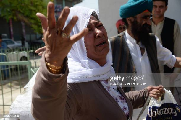 An Afghan Sikh woman weeps during a burial ceremony following a suicide attack in Jalalabad on July 2 a day after the attack Grief mixed with anger...