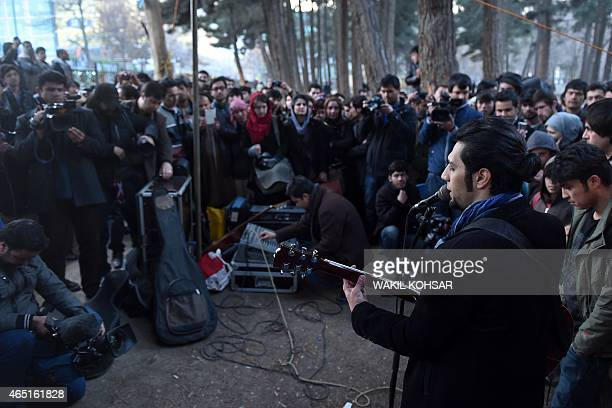 An Afghan singer performs during a street concert at Park ShahreNaw in Kabul on March 3 2015 Afghan artists and civil society activists staged a...