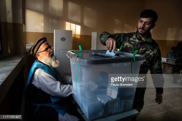 An Afghan soldier casts his ballot during light turnout and sporadic violence in today's Presidential election on September 28, 2019 in Kabul,...