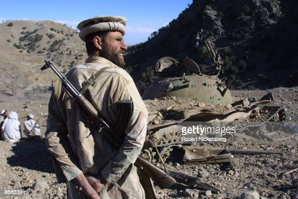 An Afghan soldier from the Eastern Shura walks through the bombed out Al Qaeda training center that was destroyed by US bombs one week ago December...