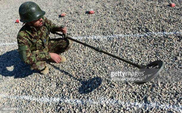 An Afghan soldier uses a mine detector during a demining drill at camp Shaheen a training facility for the Afghan National Army located west of...