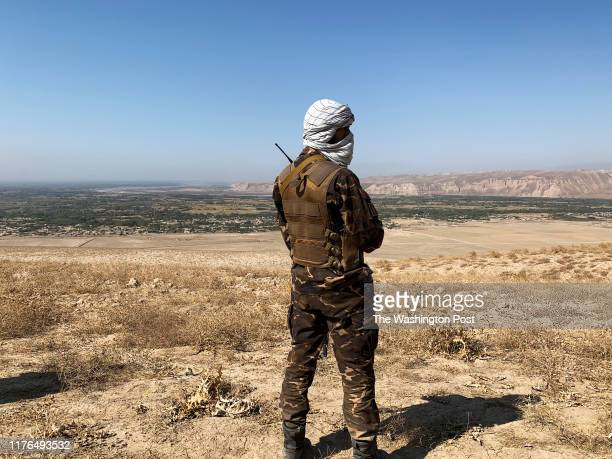 An Afghan solider with the countrys main intelligence agency looks out over Taliban held territory in Dashti Archi district. The area is home to...