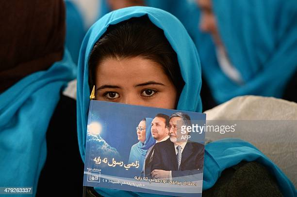 An Afghan supporter holds a flag bearing the image of Afghan second vicepresidential candidate Habiba Surabi as she attends an election rally in...