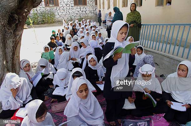 An Afghan teacher looks at students during a lesson in Mihtarlam the capital of Laghman province east of Kabul on May 15 2012 Afghanistan's education...