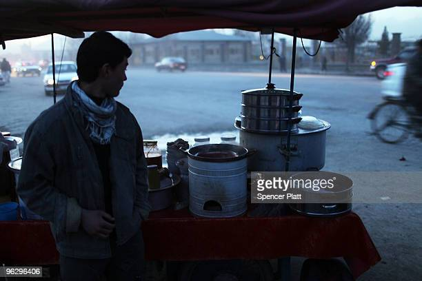An Afghan teenager sells food at dusk January 31 2010 in Kabul Afghanistan Despite years of foreign involvement and the money being committed to...