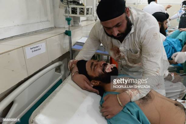 TOPSHOT An Afghan victim receives treatments at an hospital following a suicide attack in Jalalabad on July 1 2018 An explosion in a city in eastern...