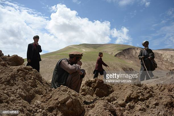 An Afghan villager cries as others search through debris at the scene in the landslidehit Aab Bareek village in Argo district of Badakhshan on May 5...
