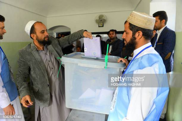 An Afghan voter casts his ballot at a polling centre for the country's legislative election in Herat province on October 20 2018 Afghans are bracing...