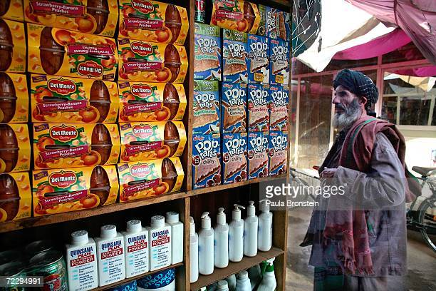 An Afghan walks by American products at the Bush Bazaar October 29 2006 in Kabul Afghanistan The small black market named after US President George W...
