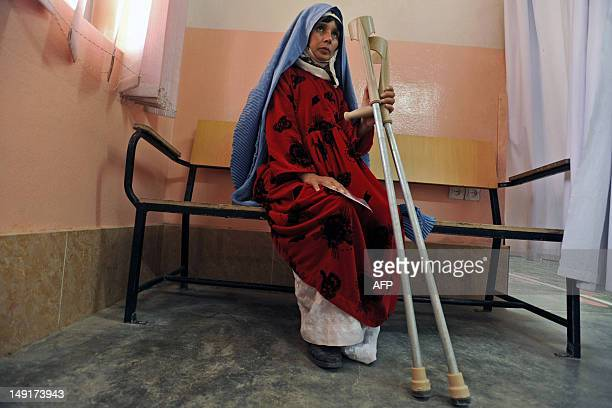 An Afghan woman amputee waits to get a prosthetic leg at the International Committee of the Red Cross hospital for war victims and the disabled in...