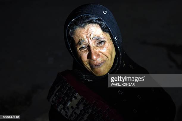 An Afghan woman cries as she looks for her son after a suicide attack at the entrance to the Police Academy in Kabul on August 7 2015 Two suicide...