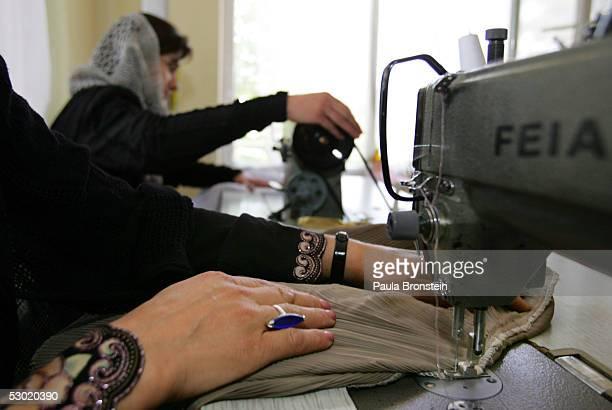 An Afghan woman sews a burqa shirt at the workshop at 'Sara Afghan' June 4 2005 in Kabul Afghanistan June 4 2005 in Kabul Afghanistan Sara Rahmani...