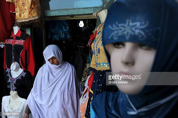 An Afghan woman shops at a market in Kabul on September 7 2010 Afghanistan prepares for its next test as an infant democracy a crop of bright young...