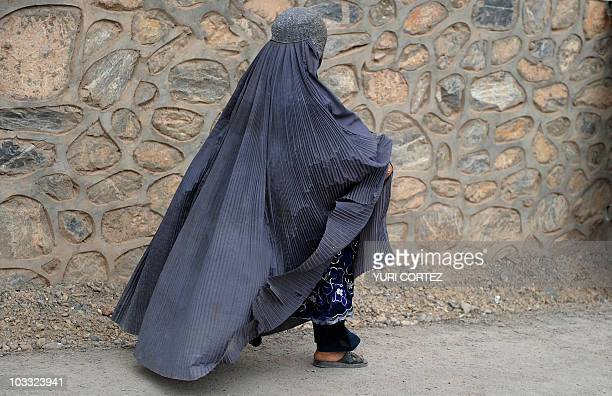 An Afghan woman walks down the street in Kandahar province's Arghandab Valley on August 10 2010 NATO and the United States have close to 150000...