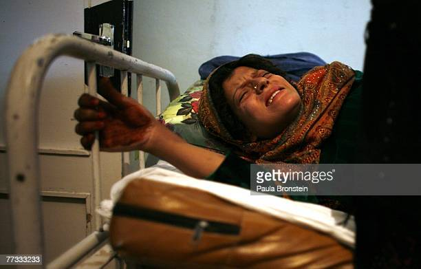 An Afghan women ready to give birth grimaces with labor pains at the Malalai Maternity hospital on October 14 2007 in Kabul Afghanistan According to...
