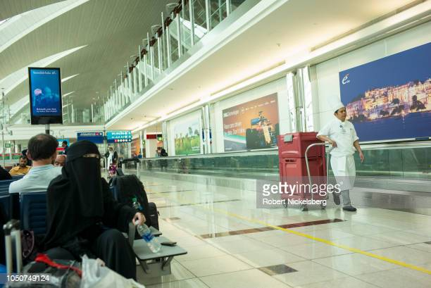 An Afghan women wearing a niqib left waits to board a flight to Kabul Afghanistan September 16 2018 at the Dubai International Airport in Dubai...