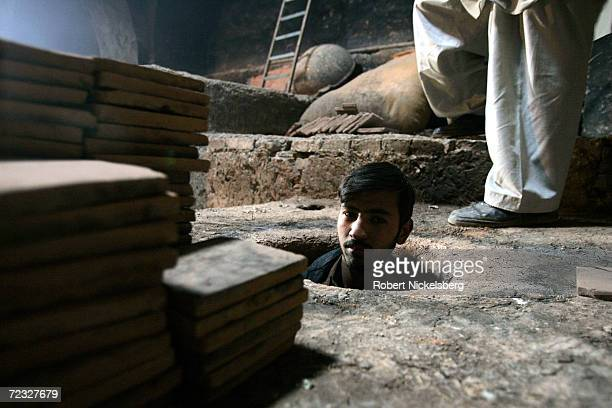 An Afghan worker exits a wood fired kiln inside the 12th century Blue Mosque on February 17 2005 in Herat Afghanistan Herat's Blue Mosque is...