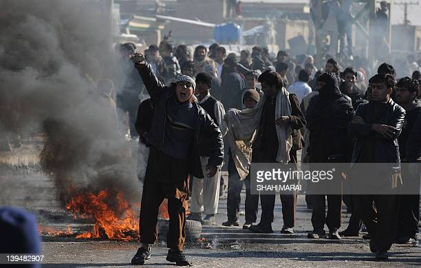 An Afghan youth shouts antiUS slogans during a protest against Koran desecration in Kabul on February 22 2012 Shots were fired into a crowd of antiUS...