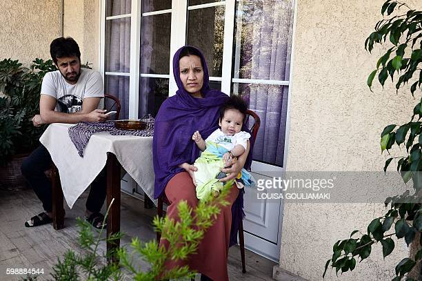 An Afghani refugee holds her newborn daughter at the hotel run by Doctors Without Borders where they live on the island of Samos on September 1 2016...