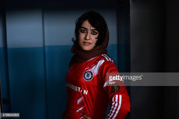 An Afghanistan national powerlifting team member poses after a training session at a women's gym in a small training room at the Kabul Stadium in...