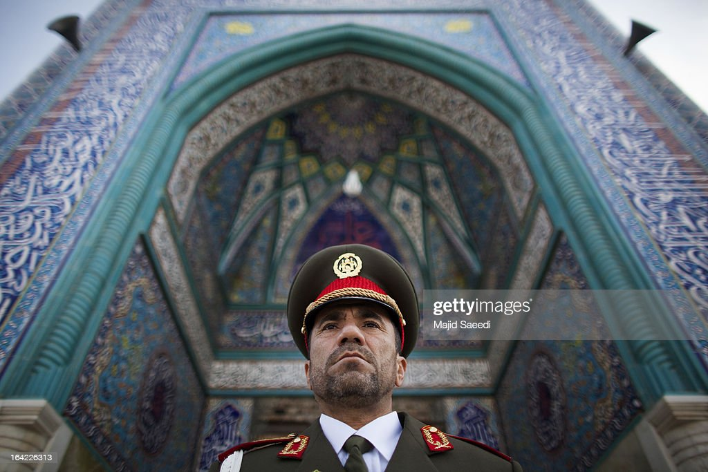 An Afghanistan policemen stands near the Sakhi shrine, which is the centre of the Afghanistan new year celebrations during the Nowruz festivities on March 21, 2013 in Kabul, Afghanistan. Nowruz is an ancient festival which marks the beginning of the spring equinox and the start of the year in the Iranian calendar, which this coming year will be 1392.