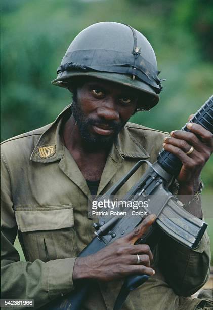 An AFL soldier holds his assault rifle during the Liberian Civil War AFL forces under pressure from Ghanaian ECOMOG forces are defending the...