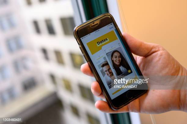 An AFP journalist holds his phone showing the dating application Bumble on February 26, 2020 in Washington,DC. - Days ahead of the Iowa Caucuses...