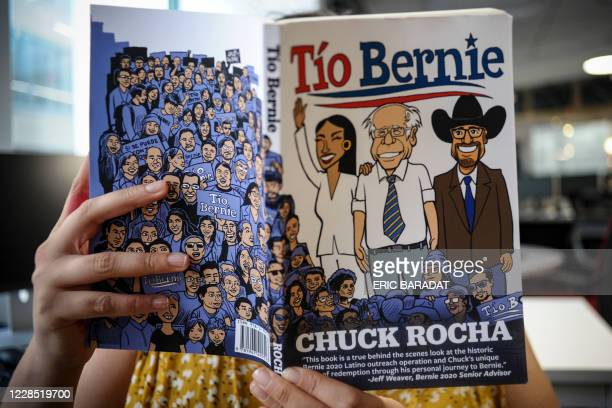 """An AFP journalist reads """"Tio Bernie"""", a book on the Latino vote by strategist Chuck Rocha in Washington, DC on September 8, 2020. - Chuck Rocha, is..."""