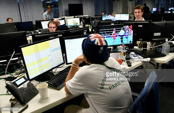 An AFP journalists is seen at work at the Main Press Center of the Rio 2016 Olympic games on August 15 2016 in Rio de Janeiro An AFP team of more...