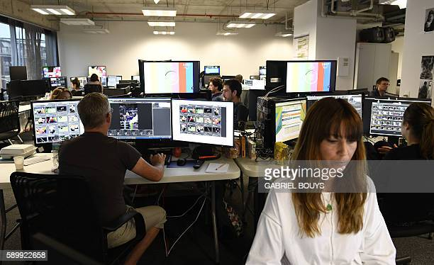 An AFP photo editor is seen at work at the Main Press Center of the Rio 2016 Olympic games on August 15 2016 in Rio de Janeiro An AFP team of more...