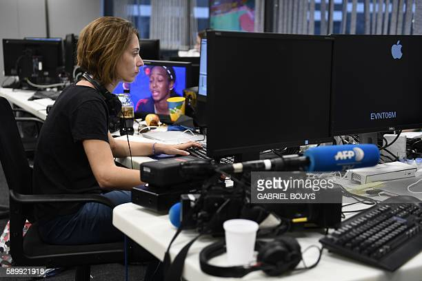 An AFPTV journalists is seen at work at the Main Press Center of the Rio 2016 Olympic games on August 15 2016 in Rio de Janeiro An AFP team of more...
