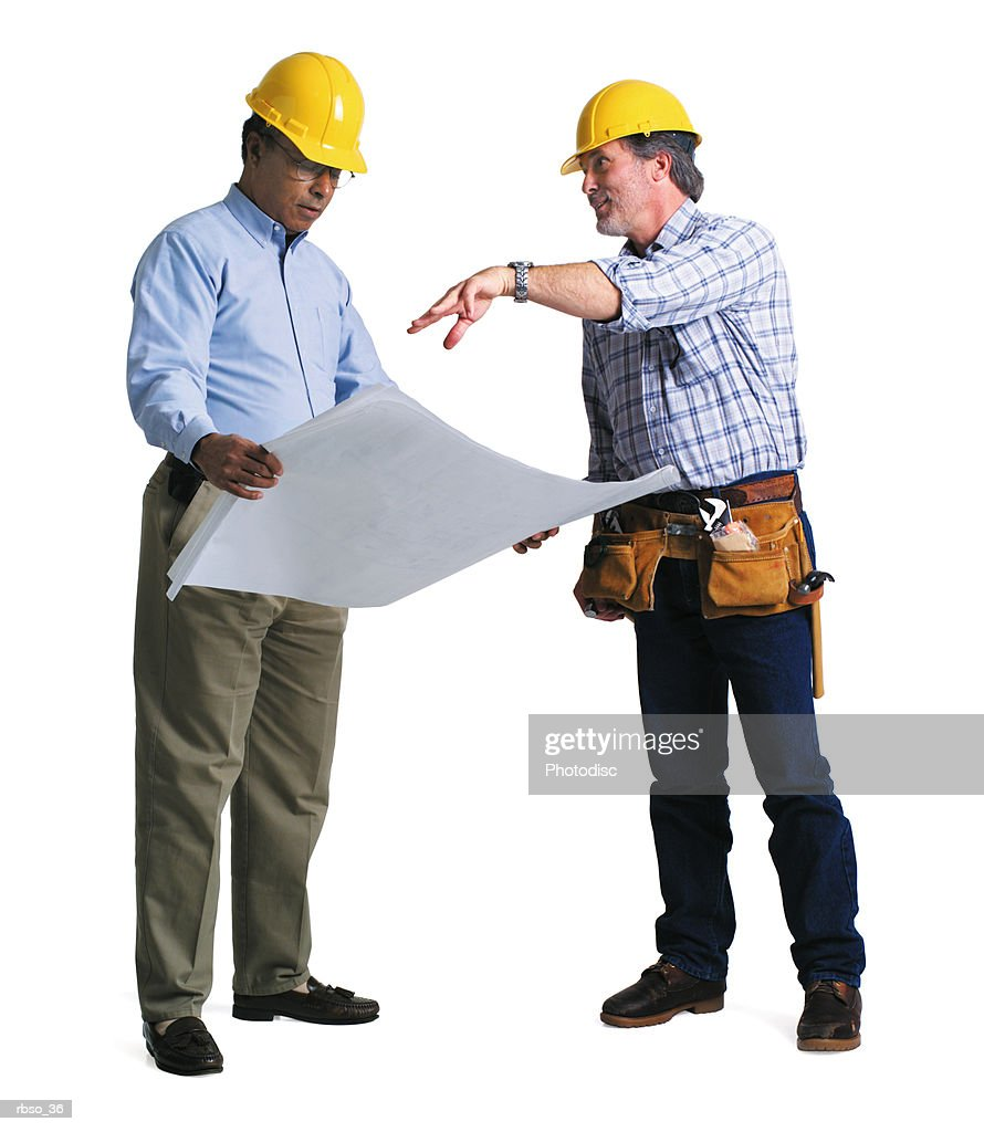 an african american contractor discusses the plans with a caucasian foreman : Foto de stock