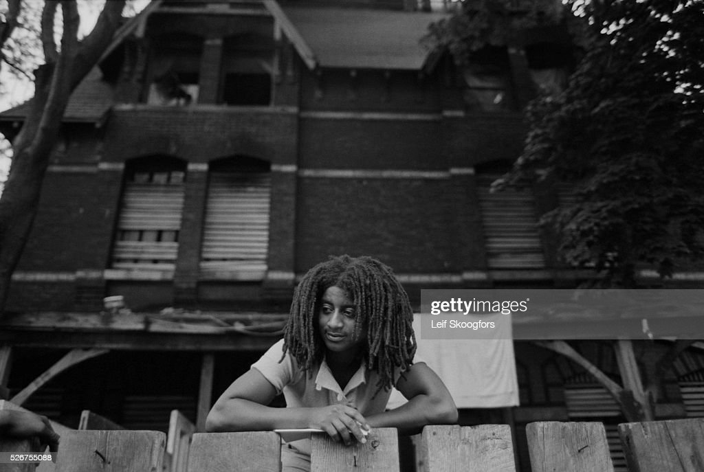 An African American cult member of MOVE, founded by John Africa, stands at the fence in front of their barricaded house in the Powelton Village section of Philadelphia, Pennsylvania.
