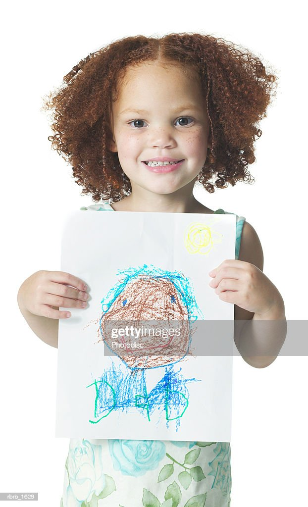 an african american female child with curly hair shows off a drawing she did with crayons : Stockfoto