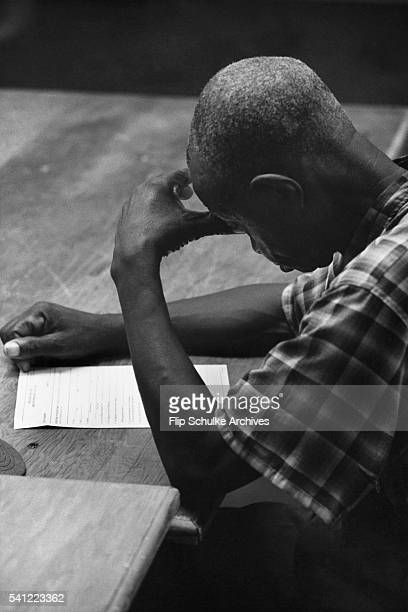 An African American man registers to vote for the first time in Marion, Alabama, following the Voting Rights Act of 1965.