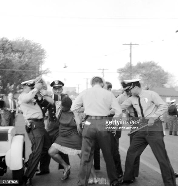 An African American woman fights with policemen during a protest against segregation organized by Reverend Dr Martin Luther King Jr and Reverend Fred...