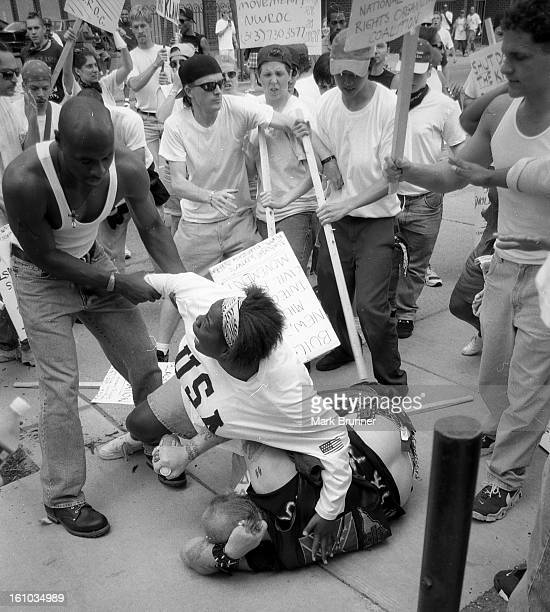 CONTENT] An African American woman save a nazi from serious harm at a protest in Ann Arbor Mi June 22 1996 A dozen members of a selfanointed and...