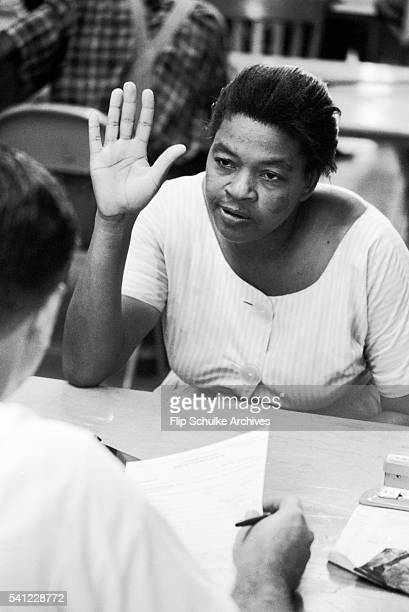 An African American woman swears an oath as she registers to vote in Alabama after enactment of the Voting Rights Act