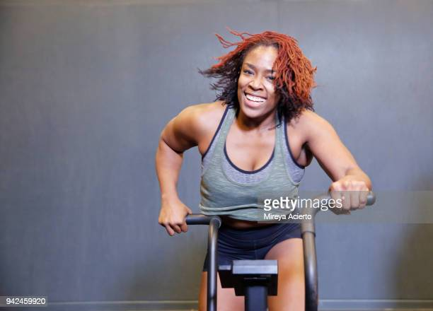 An African American woman working out in Gym